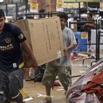 Men carry a refrigerator from a store being ransacked in Veracruz, Mexico, Thursday Jan. 5, 2017. Anger over gasoline prices hikes is fueling more protests and looting. Officials say the unrest has resulted in the death of a policeman, the ransacking of hundreds of stores and arrests of hundreds of people. (AP Photo/Felix Marquez) Mexico Gasoline Shock