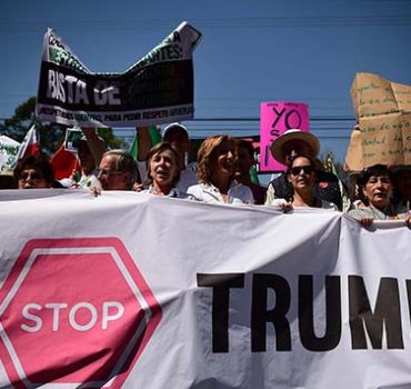 "People hold sugns against US President Donald Trump during an anti-Trump march in Mexico City, on February 12, 2017. Mexicans took to the streets against US President Donald Trump, hitting back at his anti-Mexican rhetoric and vows to make the country pay for his ""big, beautiful"" border wall. / AFP PHOTO / RONALDO SCHEMIDT"